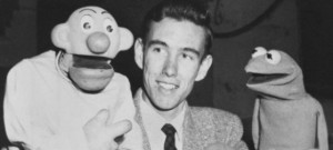 Henson with some puppets, including an early version of Kermit The Frog
